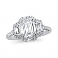 R Emerald cut and Trapeze 3 stone with a surrounding Single Halo, mounted in Platinum