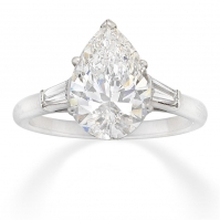 Platinum Pear Shape And Tapered Baguette Diamond Three Stone