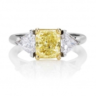 Platinum Natural Yellow Diamond And Trilliant Cut Three Stone Ring